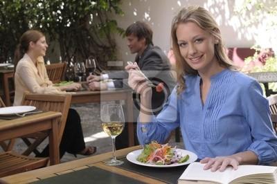 Beautiful girl in an outdoors cafe