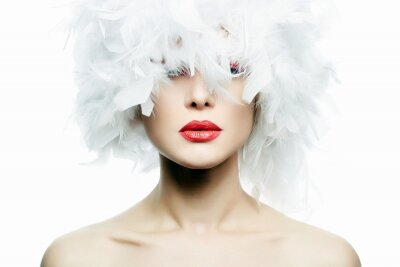 Wall mural Beautiful Girl in white feathers Hat. Make-up