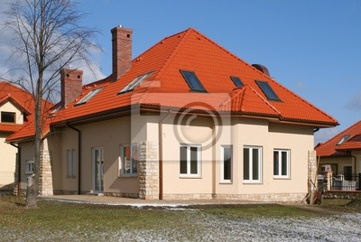 Beautiful home with red roof.