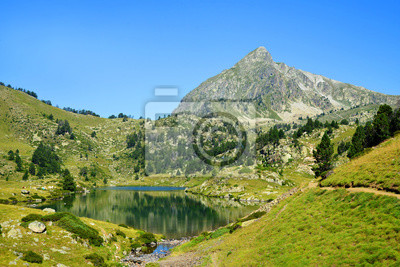 Beautiful mountain landscape in Neouvielle national nature reserve, Lac du Milieu, French Pyrenees.