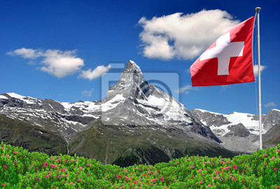 Wall mural Beautiful mountain Matterhorn with Swiss flag - Swiss Alps