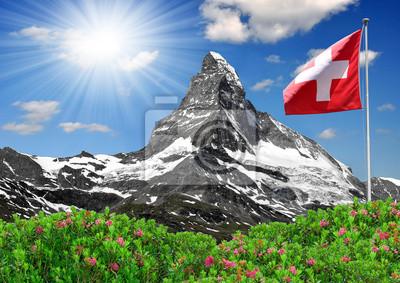 Beautiful mountain Matterhorn with Swiss flag - Swiss Alps