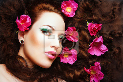 beautiful red head girl with pink flowers in her hair