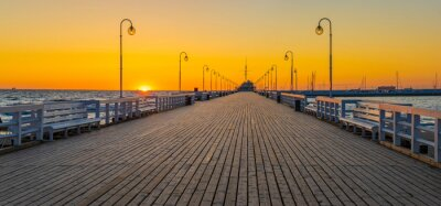 Wall mural Beautiful sunrise over a wooden pier on the Baltic Sea. Sopot, Poland.