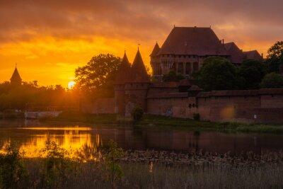 Beautiful sunrise over the Malbork Castle