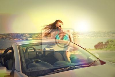 beautiful woman in a cabrio