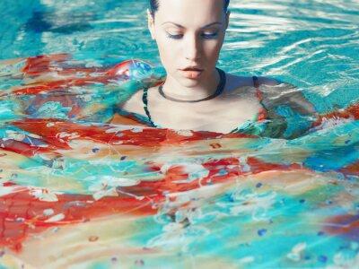 Wall mural Beautiful woman in the pool