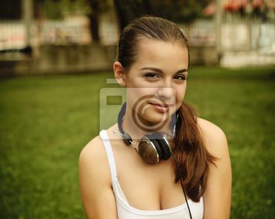 Beautiful young girl with headphones