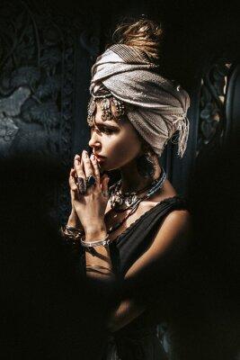Wall mural beautiful young stylish woman wearing turban outdoors portrait