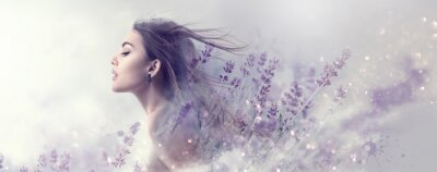 Wall mural Beauty model girl with lavender flowers . Beautiful young brunette woman with flying long hair profile portrait. Fantasy watercolor