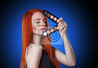 Beauty red head girl with makeup eye shadows. Makeover. Perfect