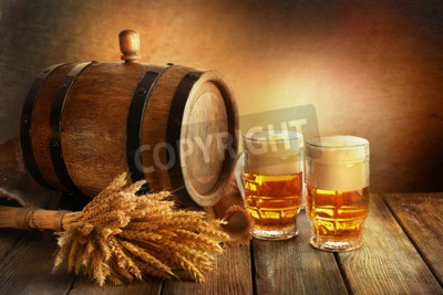 Wall mural Beer barrel with beer glasses on table on brown background
