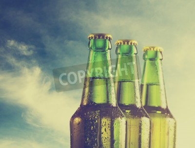 Wall mural Beer bottles on the beach. Retro filter.