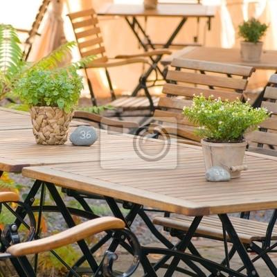 Beer garden season, summer mood, wooden furniture