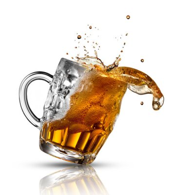 Wall mural Beer splash in glass isolated on white