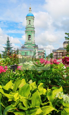 Bell tower and flowers in Optina monastery