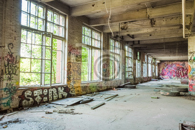 Big windows in old abandoned factory hall