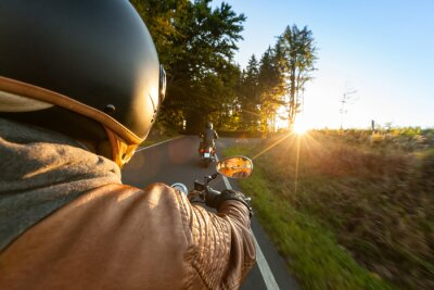 Wall mural Biker riding motorcycle  in sunny morning