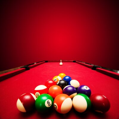 Wall mural Billards pool game. Color balls in triangle, aiming at cue ball