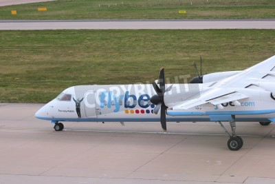 Wall mural BIRMINGHAM, UK - APRIL 24, 2013: Pilots taxi Flybe Bombardier Dash 8 Q-400 at Birmingham Airport, UK. Flybe carried 7.6 million passengers in 2013.