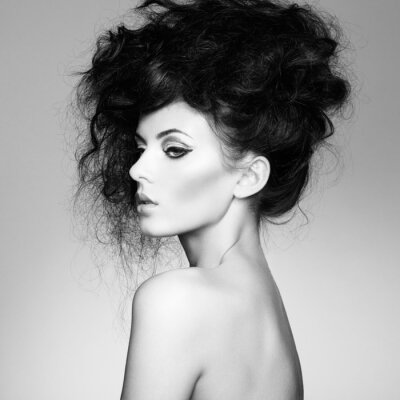Wall mural Black and white photo of beautiful woman with magnificent hair