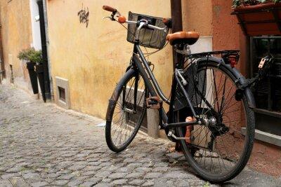Wall mural Black classic bike on a Roman street