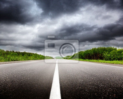 black clouds and road