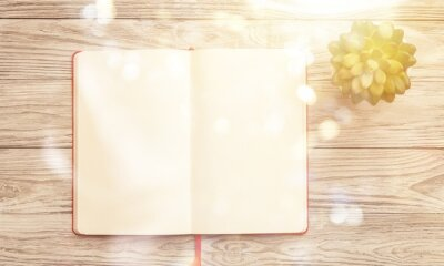 Blank notebook on wooden background