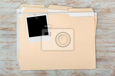 Blank photo on business folder on wooden