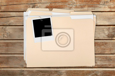 Blank photo on business folder on wooden table