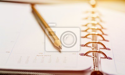 Blank spiral notebook and pen on wooden