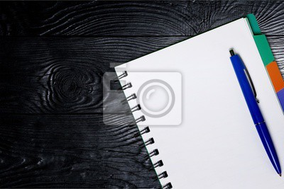 Blank student notebook and pen