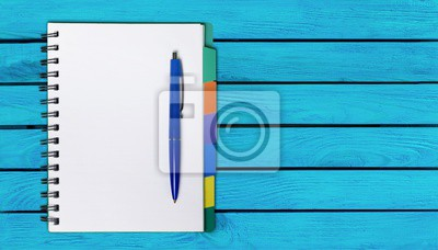 Blank student notebook and pen, top view