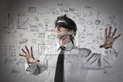 Blind businessman making plans