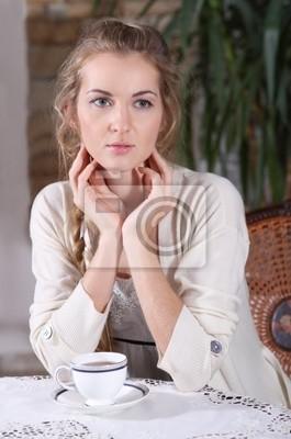 Blond girl in cafe
