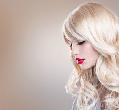 Wall mural Blonde Woman Portrait. Beautiful Blond Girl with Long Wavy Hair