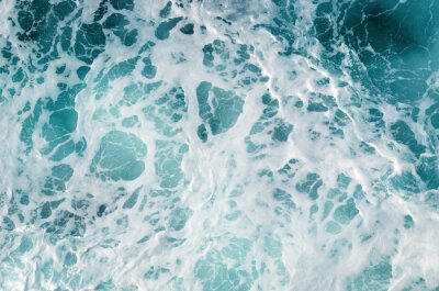 Wall mural Blue frothy surface of sea