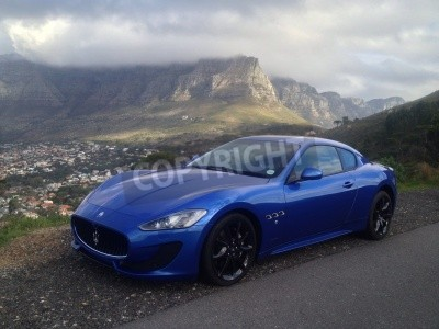 Wall mural Blue Maserati with Table Mountain in the background