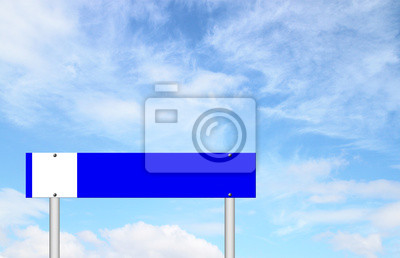 blue sign with blue sky