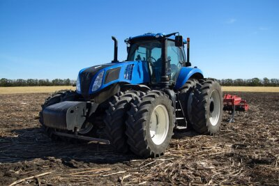 Wall mural Blue tractor with plow