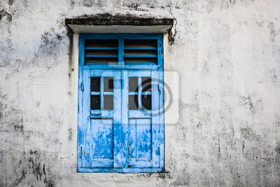 Blue wooden window and grunge wall