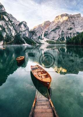 Wall mural Boats and slip construction in Braies lake with crystal water in background of Seekofel mountain in Dolomites in morning, Italy Pragser Wildsee
