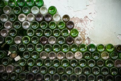 Wall mural Bottom of the bottle texture. Glass,Dirty empty wine bottles close-up,Bottom of green bottle pattern background