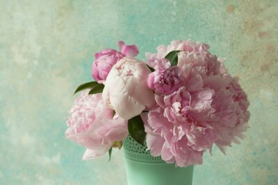 Wall mural Bouquet of pink peonies in a vase on a light colored background