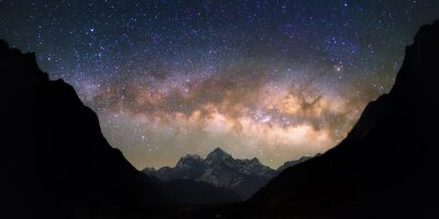 Wall mural Bowl of Heavens. Bright and vivid Milky Way galaxy over the snowy mountains. Beautiful starry night sky seems to be in a