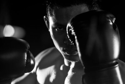 Wall mural Boxing man ready to fight. black and white