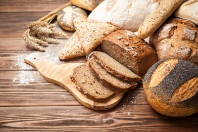 Wall mural Bread assortment on wooden surface