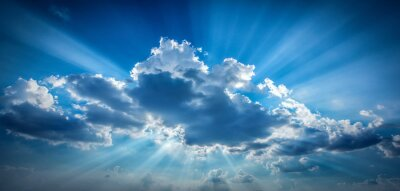 Bright sun shining in clouds on sky. Good background on the theme of religion, freedom, etc.