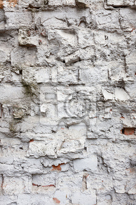 Broken old white brick wall