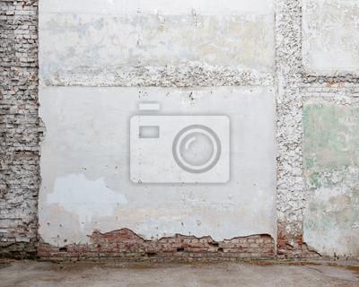 Broken old white plaster brick wall